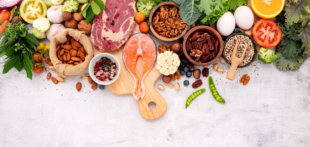 healthy-food-with-wooden-cutting-board-white-marble-background_35641-3757